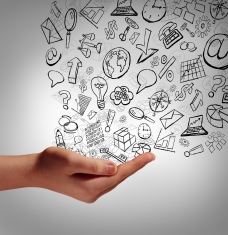 Marketing communication concept as a human hand holding business icons spreading the finanial elements upward as a symbol and metaphor for promotion advertising strategy or corporate training and education on the internet.